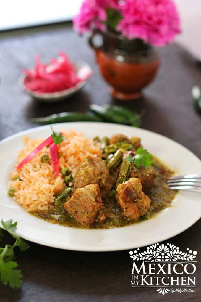 Pork spare ribs in salsa verde, a delicious tomatillo and serrano peppers green sauce.