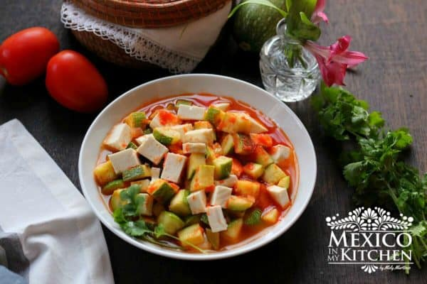 Mexican squash with cheese and tomato sauce