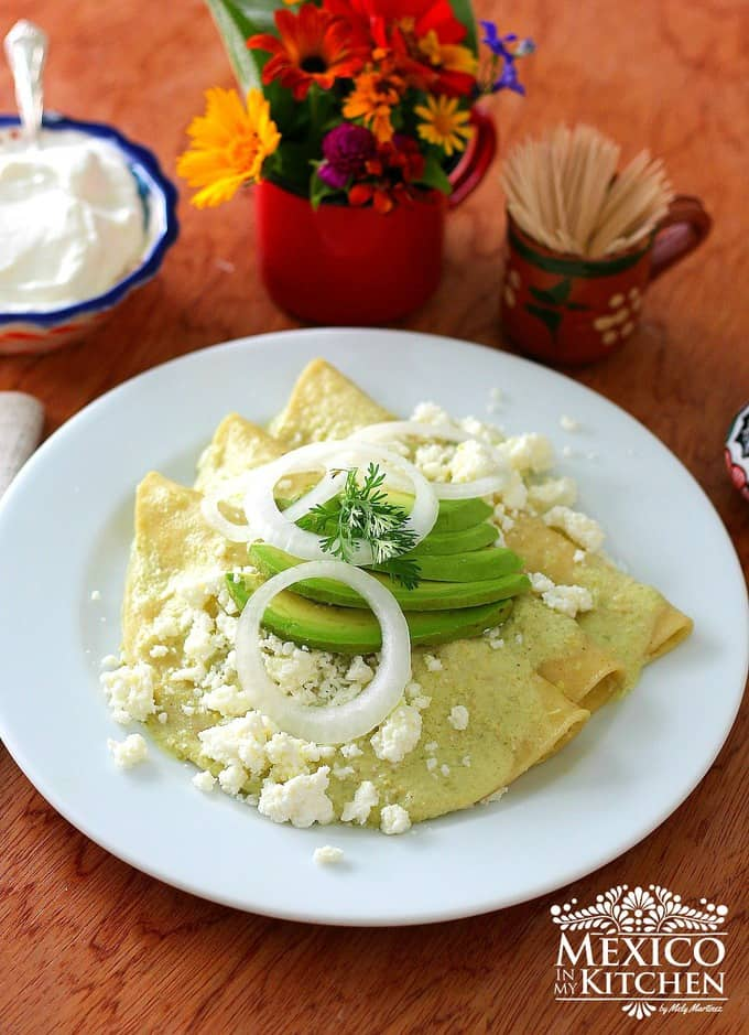 Cream enchiladas recipe topped with avocado slices and crumbled cheese- 1