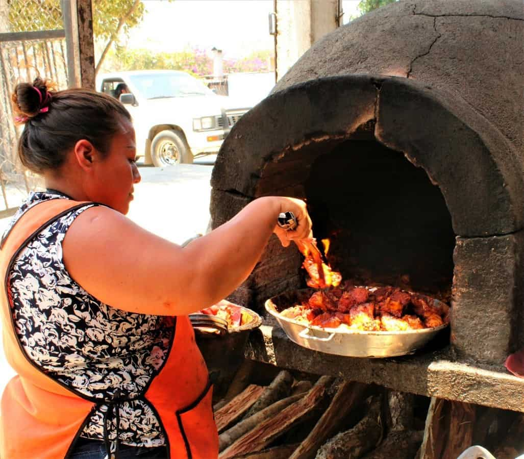Woman roasting pork