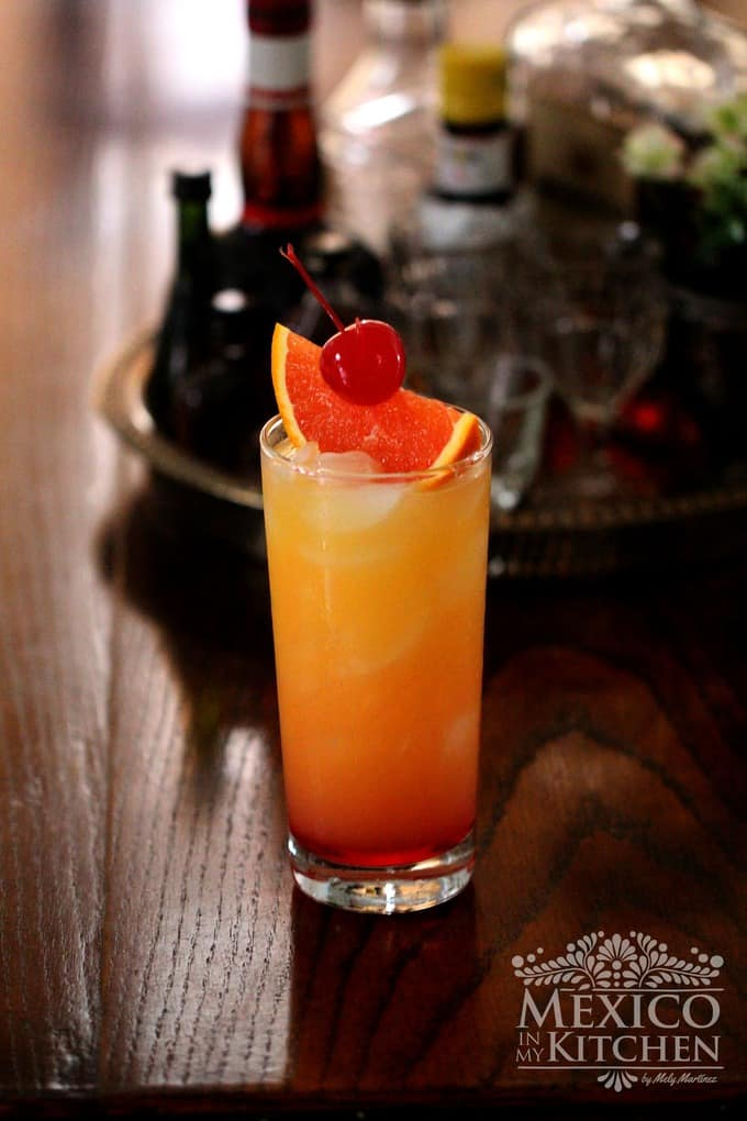 Tequila sunrise cocktail with tequila, orange juice and grenadine.