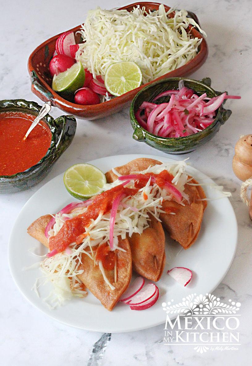 crispy tacos stuffed with Cod fish